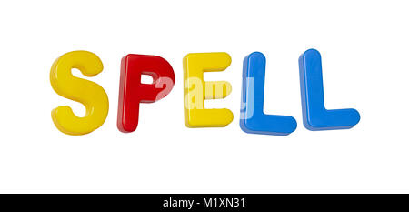 The word 'spell' made up from coloured plastic letters - Stock Photo