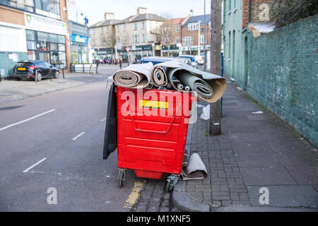 Over flowing rubbish bin - Stock Photo