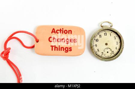 brown clay plate . text action changes things on white background - Stock Photo