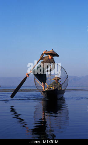 Myanmar (Burma). Inle Lake. Fishermen of Intha-tribe fishing in traditional way. - Stock Photo