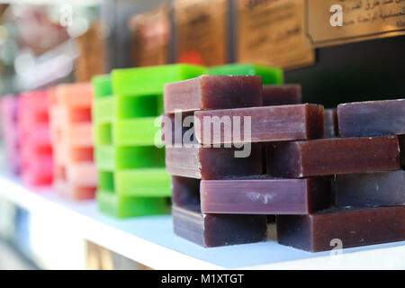 Istanbul, Turkey - May 11, 2016:  Isolated Stacked Colorful Hand Made Soaps view from souvenir shop - Stock Photo