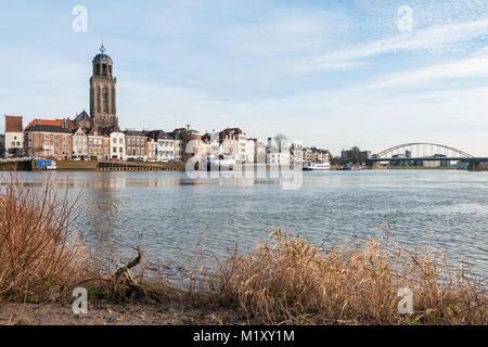 DEVENTER, THE NETHERLANDS - JANUARY 18, 2014: The historic center of Deventer with the Lebuinus Church and the river - Stock Photo