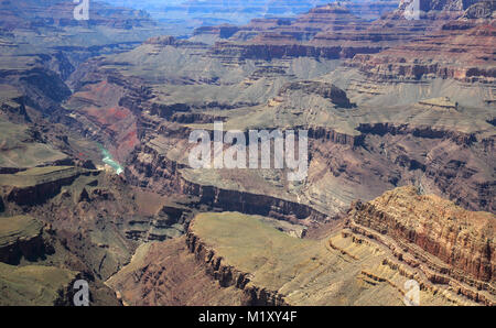 distant views of the colorado river flowing through the grand canyon in arizona - Stock Photo