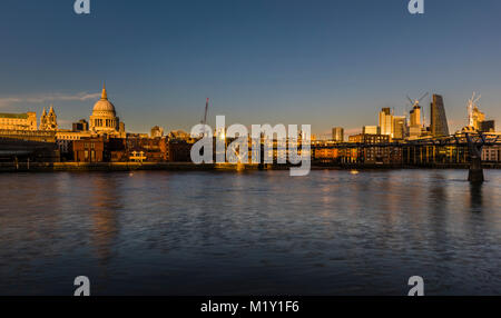 St Paul's Cathedral overlooking the River Thames at sunset, Bankside, London, UK - Stock Photo