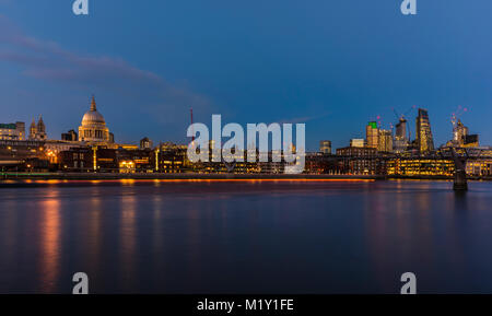 St Paul's Cathedral overlooking the River Thames at dusk, Bankside, London, UK - Stock Photo