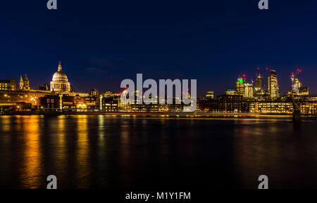 St Paul's Cathedral overlooking the River Thames at night, Bankside, London, UK - Stock Photo