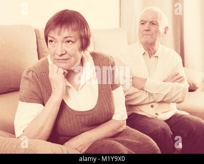 Husband and wife having disagreement with each other at home - Stock Photo