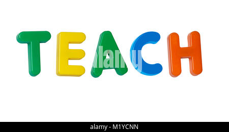The word 'teach' made up from coloured plastic letters - Stock Photo