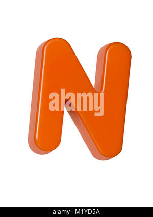 A cut out shot of an orange plastic letter 'N' - Stock Photo
