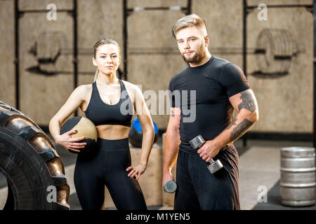 Young couple in the gym during the break - Stock Photo