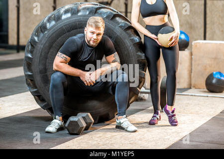 Couple during the break in the gym - Stock Photo