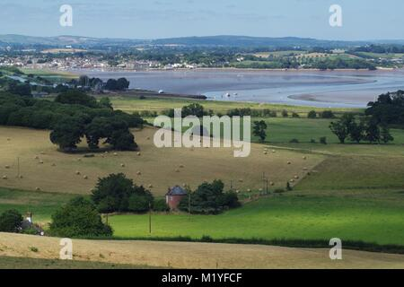 View over Devon Farmland towards the Exe Estuary, Exeter Ship Canal and Topsham. Round House in Foreground. Powderham - Stock Photo