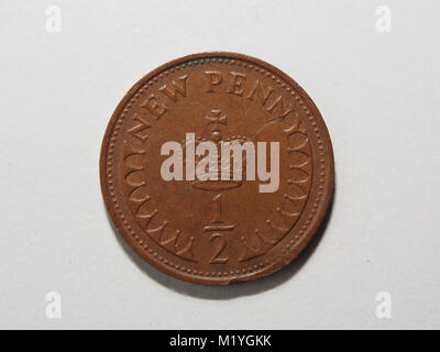 An old British half penny coin - Stock Photo