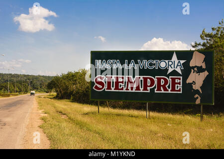 Havana, Cuba - December 7, 2017: Propaganda sign with phrase of Ernesto Che Guevara with text 'Ever onward to victory' - Stock Photo