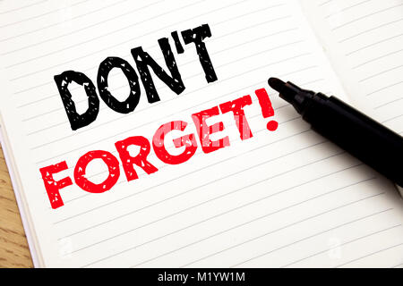 Do Not Forget. Business concept for Reminder Message written on notebook with space on book background with marker - Stock Photo