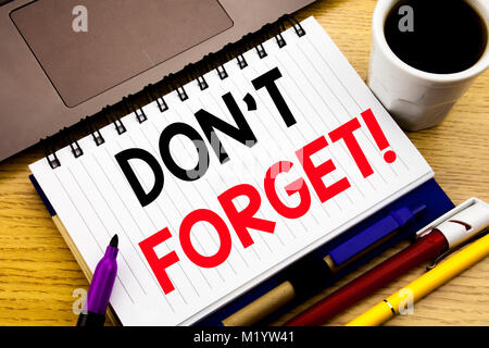 Do Not Forget. Business concept for Reminder Message written on notebook book on wooden background in the Office - Stock Photo