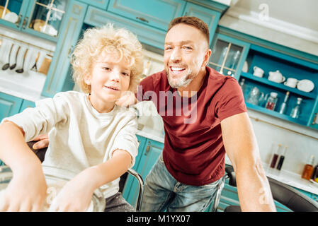 Cheerful delighted man having fun - Stock Photo