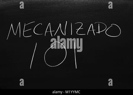 The words Mecanizado 101 on a blackboard in chalk - Stock Photo