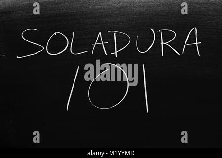 The words Soldadura 101 on a blackboard in chalk - Stock Photo