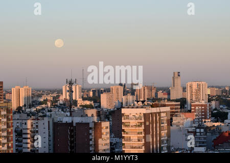 Buenos Aires/Argentina - 01-02-2018: full moon sets over Belgrano and Saavedra neighborhood of Buenos Aires city, - Stock Photo