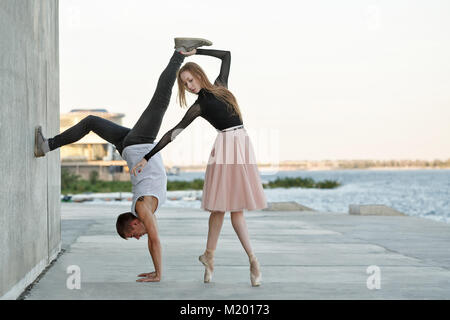 A slender ballerina dances with a modern dancer. Date of lovers. Passion and romance of dance. Modern and classical - Stock Photo