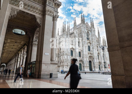 Milan Cathedral (Duomo di Milano) seen from the Vittorio Emanuele II Gallery; square Duomo in the city center of - Stock Photo