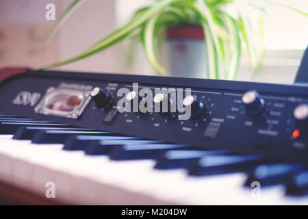 Close-up of a beautiful vintage keyboard in a recording studio (Korg SV-1) - Stock Photo