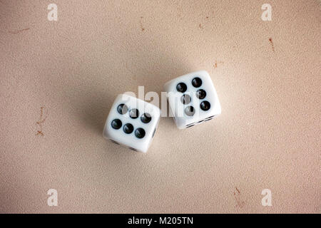 Two dice on stone background. Close-up. - Stock Photo