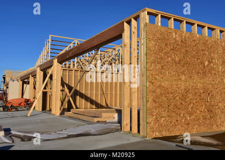 Wood frame residential building under construction Stock Photo ...
