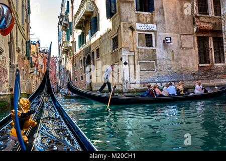 VENICE, ITALY - MAY 21, 2017: When taking a ride on a gondola in Venice, you can find another tourists on the canals - Stock Photo