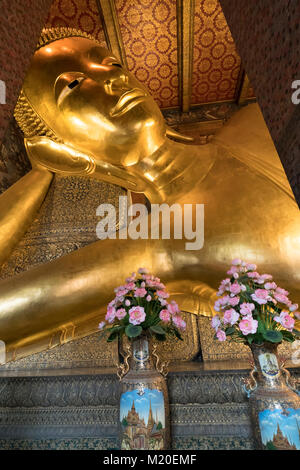 the reclining Buddha Wat Pho temple in Bangkok, Thailand - Stock Photo