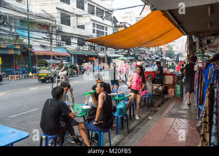 People eating on the street in Bangkok, Thailand - Stock Photo