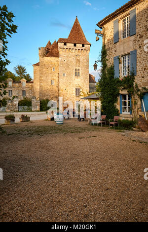 The Chateau de la Marthonie in St Jean de Cole in the Dordogne France - one of the most beautiful villages of France - Stock Photo