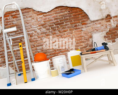 Repair in the apartment. Wall in a building construction house. Tool for repairing an apartment. - Stock Photo