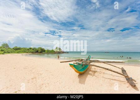 Balapitiya, Sri Lanka, Asia - A traditional, colorful canoe at the beach of Balapitiya - Stock Photo