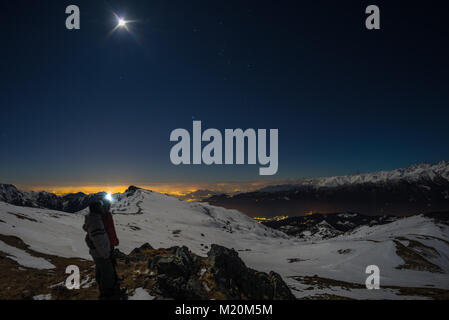 Moon and starry sky, snow on the Alps, fisheye lens. Orion Constellation, Betelgeuse and Sirio. Long exposure blurred - Stock Photo