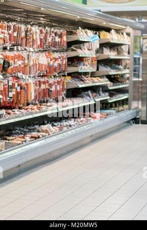 Shelves with sausage and meat products in the supermarket. blurry - Stock Photo