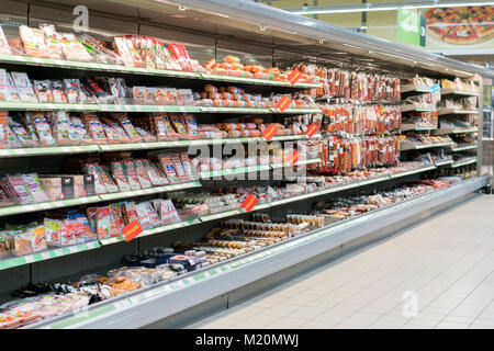 Kiev, Ukraine. February 1 2018. Shelves with sausage and meat products in the supermarket - Stock Photo