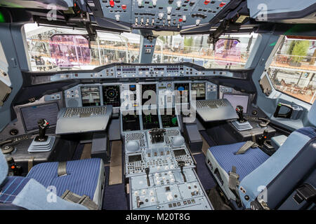 PARIS - JUN 18, 2015: Airbus A380 cockpit. The A380 is the largest passenger airliner in the world. - Stock Photo