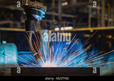 Close up torch body of robot welding - Stock Photo