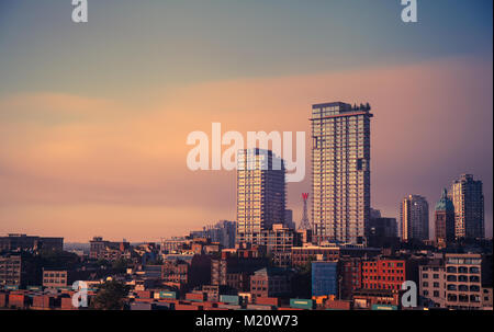 Downtown Vancouver at dawn looking east with the Woodward buildings in the background. - Stock Photo