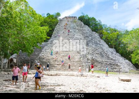 Tourists climbing on pyramid Coba Mexico - Stock Photo