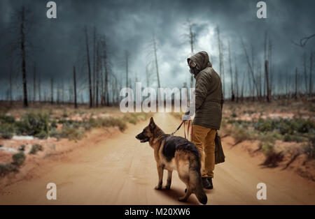 Stalker soldier in gas mask and dog in radioactive zone, survivors after nuclear war. Post apocalyptic world. Post - Stock Photo