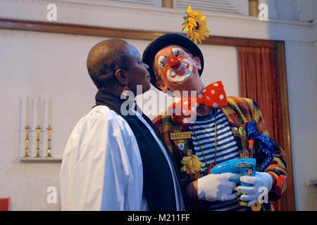 The Reverend Rose Hudson-Wilkin and Mattie the clown sharing a joke during the 62nd Annual Grimaldi Clown Church - Stock Photo