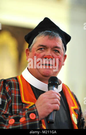 Roly the clown addressing the congregation during the 67th Annual Grimaldi Clown Church Service at Holy Trinity - Stock Photo