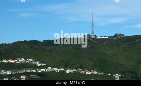 Broadmeadows houses with  native bush behind, going up to Mt Kaukau, tv transmission tower at 445mt - Stock Photo