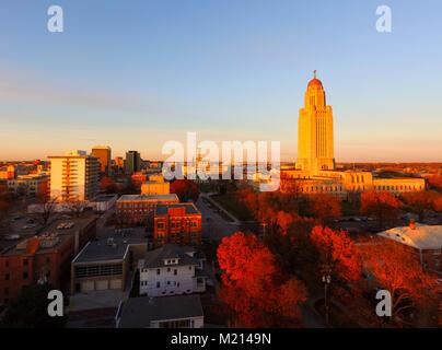 The sun sets over the State Capital Building in Lincoln Nebraska - Stock Photo
