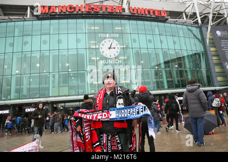Manchester, UK, 3 Feb 2018. A scarf seller outside the football ground  on the 60th anniversary of the Munich Air - Stock Photo