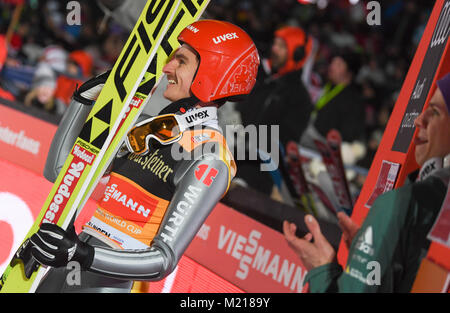 Willingen, Germany. 03rd Feb, 2018. Richard Freitag (l) of Germany is pleased after his second competition jump - Stock Photo