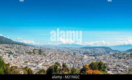 Panorama of Quito - Ecuador as seen from the Panecillo, a 200-metre-high hill of volcanic-origin - Stock Photo
